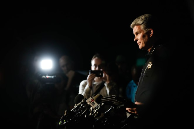 Gilroy Police Chief Scot Smithee talks to the media at a reunification center at Gavilan College in Gilroy, Calif., on Sunday, July 28, 2019. People were directed to the center following a shooting at the Gilroy Garlic Festival. (Randy Vazquez/Bay Area News Group)
