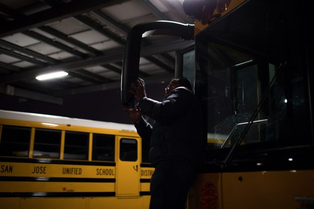 Rex Fuentes adjust a mirror on a bus at the San Jose Unified School District bus yard in San Jose, Calif., on Thursday, Feb. 28, 2019. (Randy Vazquez/Bay Area News Group)