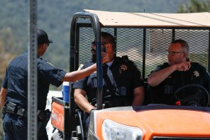 Police officers talk to each other outside of Christmas Hill Park in Gilroy, Calif., on Monday, July 30, 2019. The park was the location of the Gilroy Garlic Festival where a gunman opened fire killing three people. The gunman was also killed. (Randy Vazquez/Bay Area News Group)