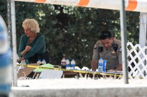 A law enforcement officer is photographed looking around a table at Christmas Hill Park in Gilroy, Calif., on Monday, July 30, 2019. (Randy Vazquez/Bay Area News Group)