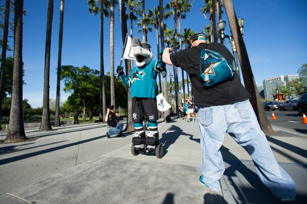 Ryan Beckerleg, right, fist bumps SJ Sharkie, left, outside of SAP Center in San Jose, Calif., on Tuesday, April 23, 2019. (Randy Vazquez/Bay Area News Group)