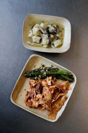 Handmade gnocchi with trumpet mushrooms, top, and pasta with bolognese sauce and grilled asparagus topped with a mixture of roasted pine nuts and pistachios, bottom, are placed on table during a class of the Quentin Cooks program at San Quentin State Prison in San Quentin, Calif., on Wednesday, May 15, 2019. The all-volunteer program, brings chefs and inmates together to teach inmates how to work in a commercial kitchen. (Randy Vazquez/Bay Area News Group)
