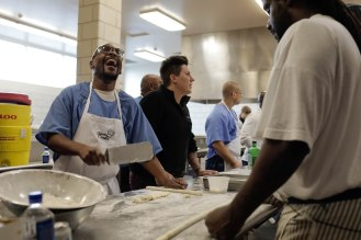 "Derry ""Brother D"" Brown, left, laughs next to Lisa Dombroski, center, during a class of the Quentin Cooks program at San Quentin State Prison in San Quentin, Calif., on Wednesday, May 15, 2019. The all-volunteer program, brings chefs and inmates together to teach inmates how to work in a commercial kitchen. Dombroski is a co-founder of the program. (Randy Vazquez/Bay Area News Group)"