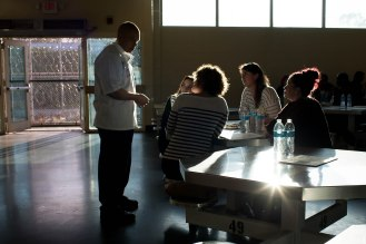 Kerry Rudd, left, talks to attendees of the graduation dinner of the Quentin Cooks program at San Quentin State Prison in San Quentin, Calif., on Wednesday, May 22, 2019. The all-volunteer program, brings chefs and inmates together to teach inmates how to work in a commercial kitchen. (Randy Vazquez/Bay Area News Group)