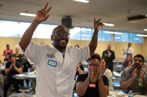 """Derry """"Brother D"""" Brown, smiles as he goes to pick up his completion certificate and Food Handler Certificate from the Marin County Department of Public Health after graduation dinner of the Quentin Cooks program at San Quentin State Prison in San Quentin, Calif., on Wednesday, May 22, 2019. The all-volunteer program, brings chefs and inmates together to teach inmates how to work in a commercial kitchen. (Randy Vazquez/Bay Area News Group)"""