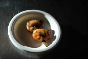 Shrimp prepared during graduation dinner of the Quentin Cooks program is placed on a table at San Quentin State Prison in San Quentin, Calif., on Wednesday, May 22, 2019. The all-volunteer program, brings chefs and inmates together to teach inmates how to work in a commercial kitchen. (Randy Vazquez/Bay Area News Group)
