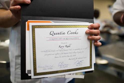 Kerry Rudd shows off his certificate of recognition for completing the Quentin Cooks program at San Quentin State Prison in San Quentin, Calif., on Wednesday, May 22, 2019. The all-volunteer program, brings chefs and inmates together to teach inmates how to work in a commercial kitchen. (Randy Vazquez/Bay Area News Group)