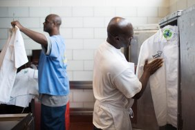 Ron Simmons, right, and Phillip Sims, left, get their chef robes ready for the graduation diner of the Quentin Cooks program at San Quentin State Prison in San Quentin, Calif., on Wednesday, May 22, 2019. The all-volunteer program, brings chefs and inmates together to teach inmates how to work in a commercial kitchen. (Randy Vazquez/Bay Area News Group)