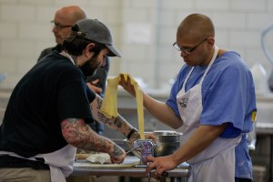 Kerry Rudd, right, and chef Adelaar Rogers, left, makes noodles during a class of the Quentin Cooks program at San Quentin State Prison in San Quentin, Calif., on Wednesday, May 15, 2019. The all-volunteer program, brings chefs and inmates together to teach inmates how to work in a commercial kitchen. (Randy Vazquez/Bay Area News Group)