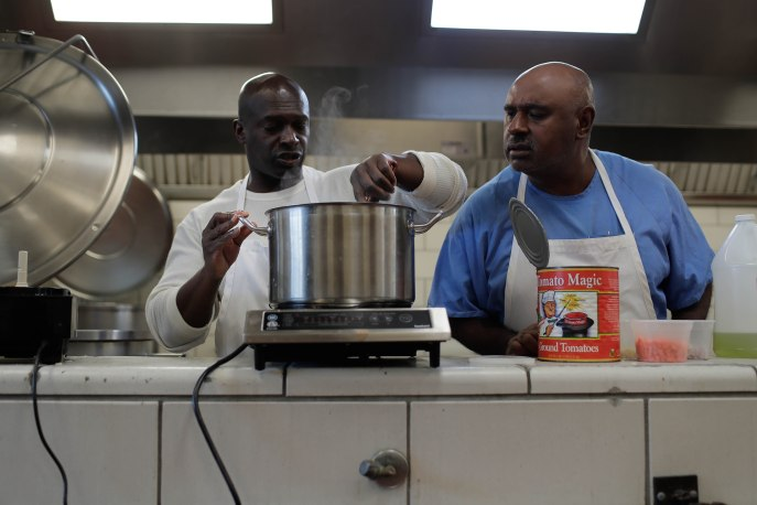 Ron Simmons, left, stirs a sauce while Tim Fielder, right, looks on during a class of the Quentin Cooks program at San Quentin State Prison in San Quentin, Calif., on Wednesday, May 15, 2019. The all-volunteer program, brings chefs and inmates together to teach inmates how to work in a commercial kitchen. (Randy Vazquez/Bay Area News Group)