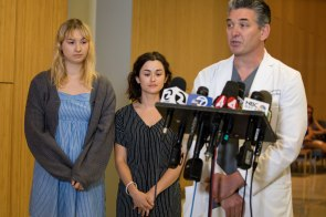 Brynn Ota-Mathews, left, Gabriella Gaus, center, and Brian Saavedra, Saint Luis Regional Hospital Emergency Department Director, right, talk to the media during a press conference at Santa Clara Valley Medical Center in San Jose, Calif., on Thursday, Aug. 1, 2019. Both Ota-Mathews and Gaus suffered gunshot wounds at the Gilroy Garlic Festival last Sunday. (Randy Vazquez/Bay Area News Group)