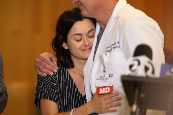 Gabriella Gaus, left, hugs Brian Saavedra, Saint Luis Regional Hospital Emergency Department Director, right, at Santa Clara Valley Medical Center in San Jose, Calif., on Thursday, Aug. 1, 2019. Gaus suffered gunshot wounds at the Gilroy Garlic Festival last Sunday. (Randy Vazquez/Bay Area News Group)
