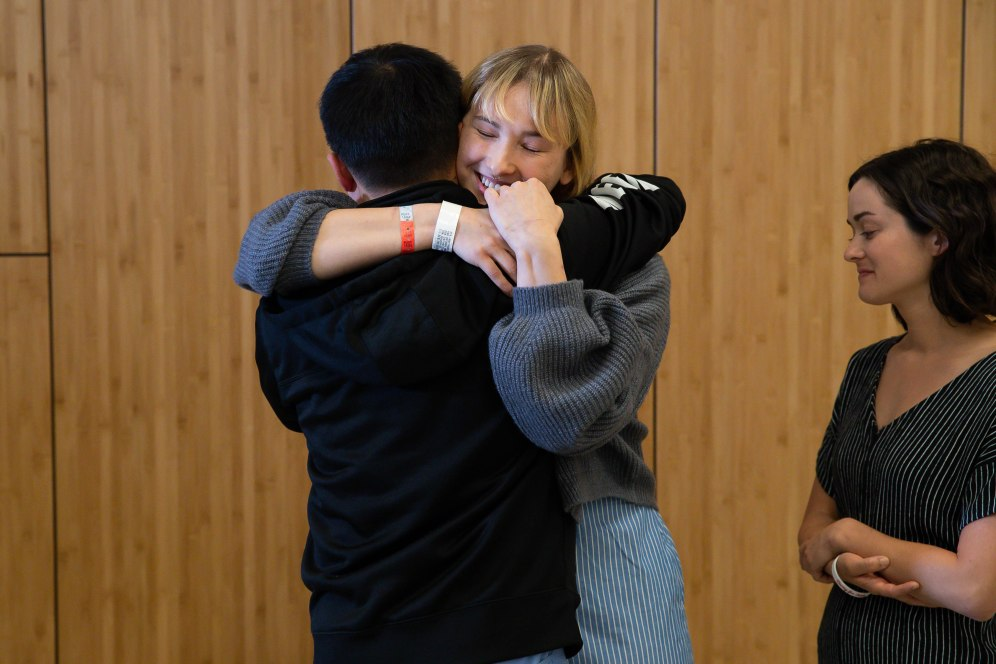 Brynn Ota-Mathews, center, hugs Jeffery Chien, Santa Clara Valley Medical Center Emergency Department Director, left, during a press conference at Santa Clara Valley Medical Center in San Jose, Calif., on Thursday, Aug. 1, 2019. (Randy Vazquez/Bay Area News Group)
