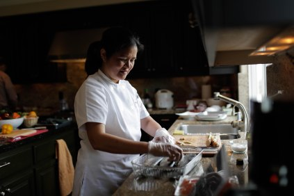Channy Laux prepares some trout in her home in Fremont, Calif., on Thursday, Feb. 7, 2019. Laux is a chef and founder of Angkor Cambodian Foods, which specializes in sauces and condiments used in Cambodian cuisine. Randy Vazquez/Bay Area News Group)