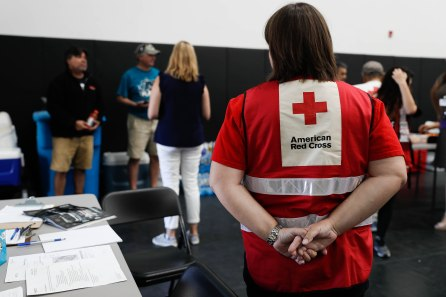 Vendors wait for a bus at a Red Cross shelter inside the gymnasium at Christopher High School in Gilroy, Calif., on Monday, July 30, 2019. (Randy Vazquez/Bay Area News Group)