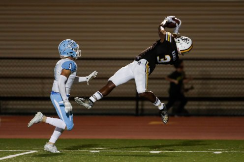 Saint Francis' Carsten Rawls (3), right, stretches out for a catch while being defended by Corona del Mar's Chandler Fincher (1), left, during the fourth quarter of their game at Saint Francis High School in Mountain View, Calif., on Friday, Aug. 30, 2019. (Randy Vazquez/Bay Area News Group)