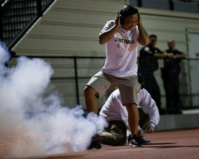 A student sets off a mini canon after Saint Francis scores a touchdown during the third quarter of their game versus Corona del Mar at Saint Francis High School in Mountain View, Calif., on Friday, Aug. 30, 2019. (Randy Vazquez/Bay Area News Group)