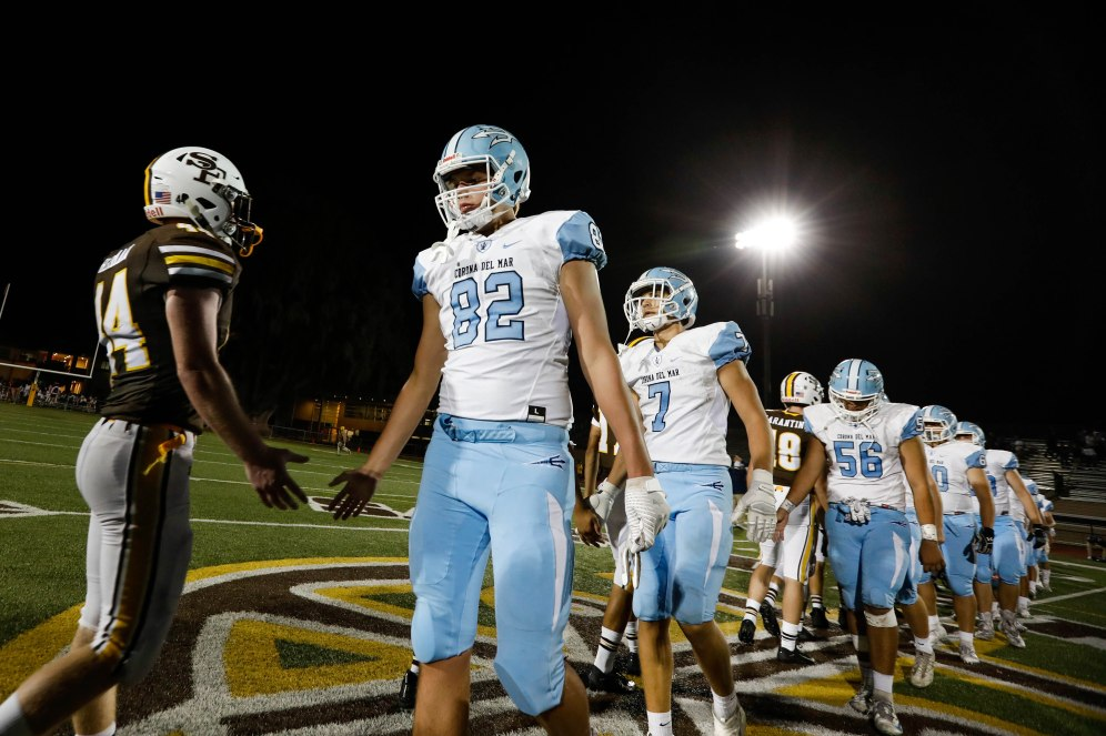Saint Francis and Corona del Mar players shake hands after their game at Saint Francis High School in Mountain View, Calif., on Friday, Aug. 30, 2019. Corona del Mar would win the game 42-14 over Saint Francis. (Randy Vazquez/Bay Area News Group)