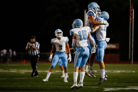 Corona del Mar players celebrate after a turnover during the second quarter of their game versus Saint Francis at Saint Francis High School in Mountain View, Calif., on Friday, Aug. 30, 2019. (Randy Vazquez/Bay Area News Group)