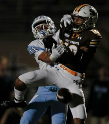 Saint Francis' Michael Artmore (10), right, tries to make an interception while Corona del Mar's Bradley Schlom (11), left, tries to stop him during the second quarter of their game at Saint Francis High School in Mountain View, Calif., on Friday, Aug. 30, 2019. (Randy Vazquez/Bay Area News Group)