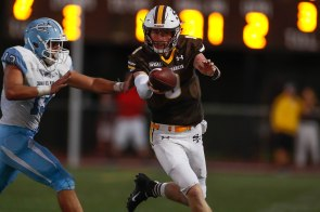 Saint Francis quarterback Ryan Daly (9), right, tries to pick up a first down while being chased by Corona del Mar's Chase Zanck (13), left, during the second quarter of their game at Saint Francis High School in Mountain View, Calif., on Friday, Aug. 30, 2019. (Randy Vazquez/Bay Area News Group)