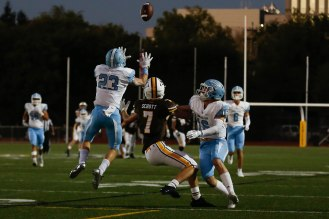 Corona del Mar's Zack Green (23) makes an interception while being on a pass intended for Saint Francis' Joey Scott (7) during the second quarter of their game at Saint Francis High School in Mountain View, Calif., on Friday, Aug. 30, 2019. (Randy Vazquez/Bay Area News Group)