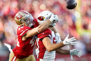 SANTA CLARA, CALIFORNIA - NOVEMBER 17: San Francisco 49ers' Kyle Juszczyk (44), left, tries to make a catch over Arizona Cardinals' Joe Walker (59), right, in the third quarter of their game at Levi's Stadium in Santa Clara, Calif., on Sunday, Nov. 17, 2019. (Randy Vazquez / Bay Area News Group)