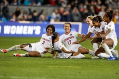 SAN JOSE, CALIFORNIA - DECEMBER 8: Stanford's Kiki Pickett (23), center, slides into her teammates after scoring the game winning penalty kicks versus North Carolina during the 2019 Women's College Cup final at Avaya Stadium in San Jose, Calif., on Sunday, Dec. 8, 2019. (Randy Vazquez / Bay Area News Group)