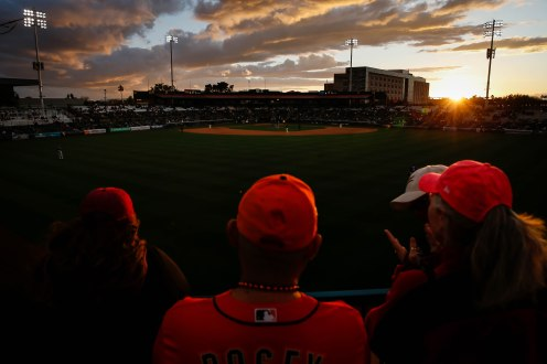 SCOTTSDALE, ARIZONA - FEBRUARY 22: People watch the game between the San Francisco Giants and Los Angeles Dodgers as the sun goes down at Scottsdale Stadium in Scottsdale, Ariz., on Saturday, Feb. 22, 2020. (Randy Vazquez / Bay Area News Group)